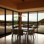 Dining Area with Walls of Glass Panels