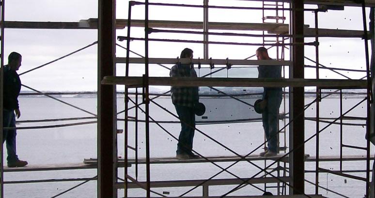 Men Installing Glass